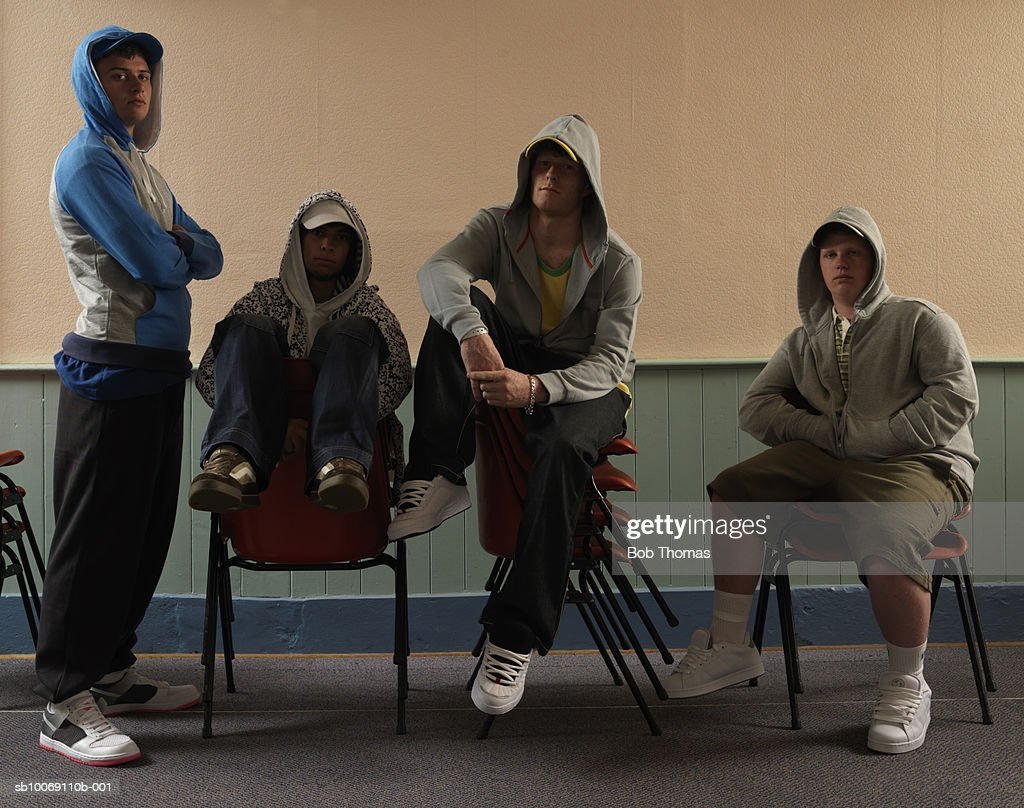 Group of young men sitting in youth club : Stockfoto