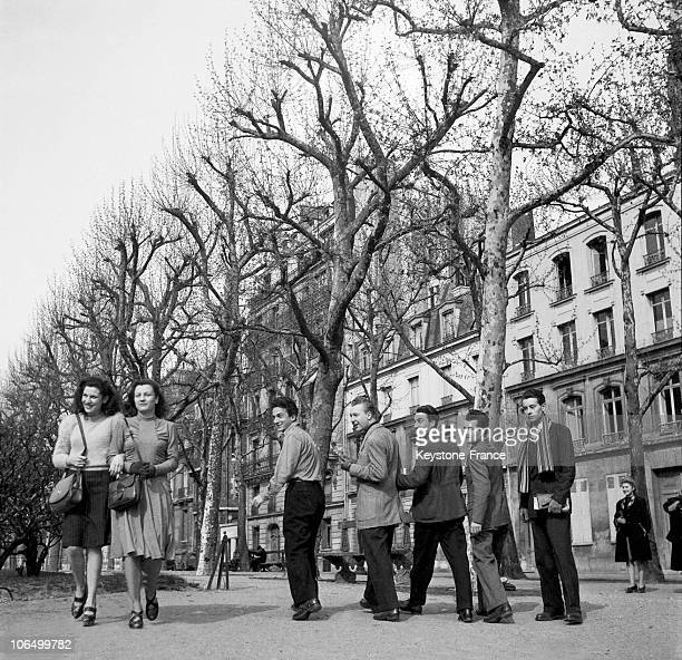 Group Of Young Men Trying To Make Acquaintance With Two Young Women In Paris On April 9 1946