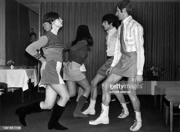 A group of young models male and female present themselves in mini skirts on 6 December 1966 in Munich Following ancient Roman and Scottish models...