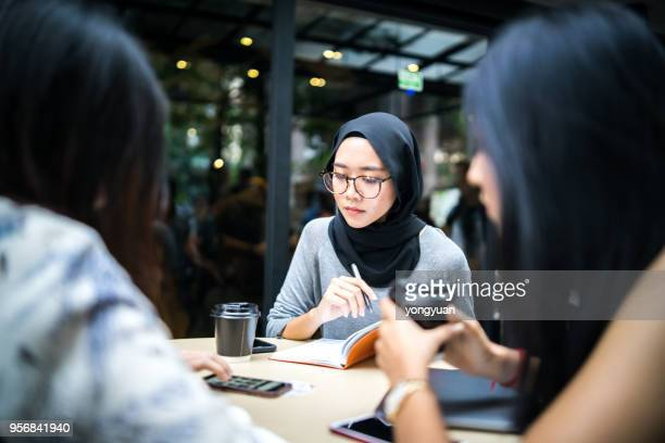 group of young multi-ethnic malaysian girls having a talk - malaysia beautiful girl stock photos and pictures