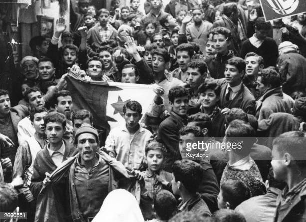 A group of young Muslims showing their flag in the Casbah after the signing of the ceasefire agreement in Algiers