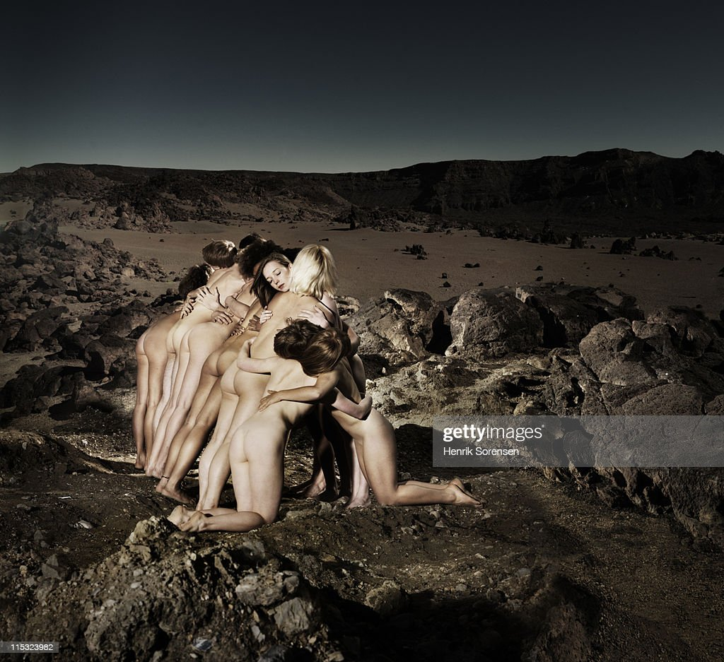 Group Of Young Naked People Embracing In Dessert Stock -5162