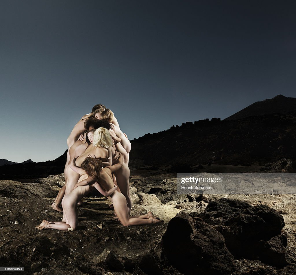 Group Of Young Naked People Embracing In Dessert Stock -1227