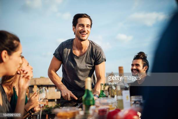 group of young people at barbecue party - party host stock pictures, royalty-free photos & images