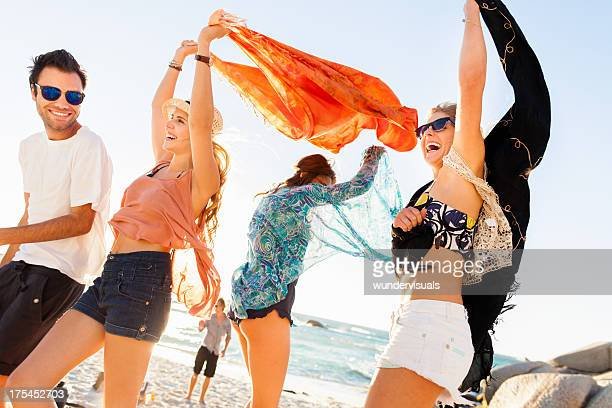 group of young people at beach party - hot teen stock pictures, royalty-free photos & images
