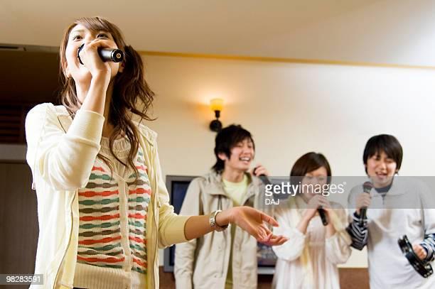 Group of young people at karaoke bar