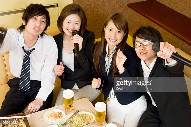 Group of young people at karaoke booth