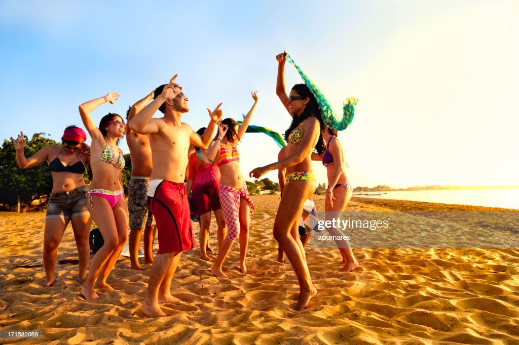 Group Of Young People At Tropical Beach Party Stock Photo