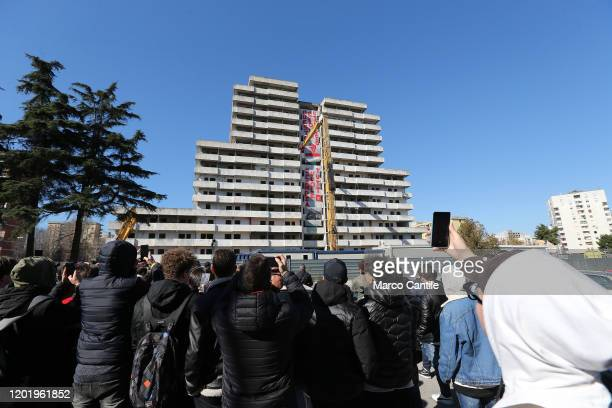A group of young people awaits the demolition of the building known as Vela Verde in the Scampia district of Naples The building is the first of...