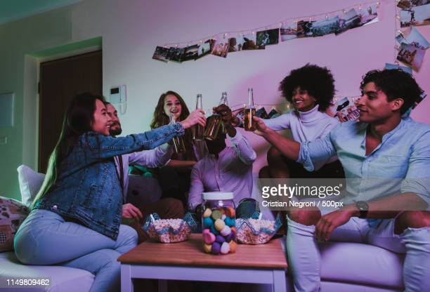 a group of young people celebrating and making party at home - drunk wife at party stock pictures, royalty-free photos & images