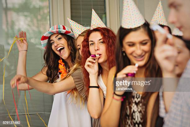 Group of young people celebrating birthday on the street