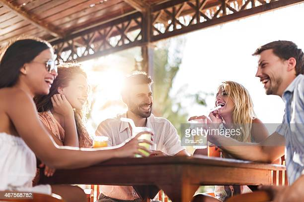 Group of young people communicating and having fun at bar.