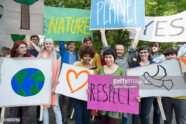 group of young people demonstrating with banners - environmental signs and symbols stock pictures, royalty-free photos & images