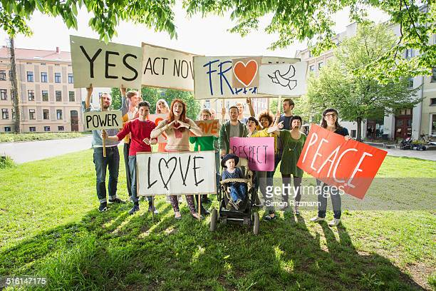 group of young people demonstrating with banners - campaigner stock pictures, royalty-free photos & images