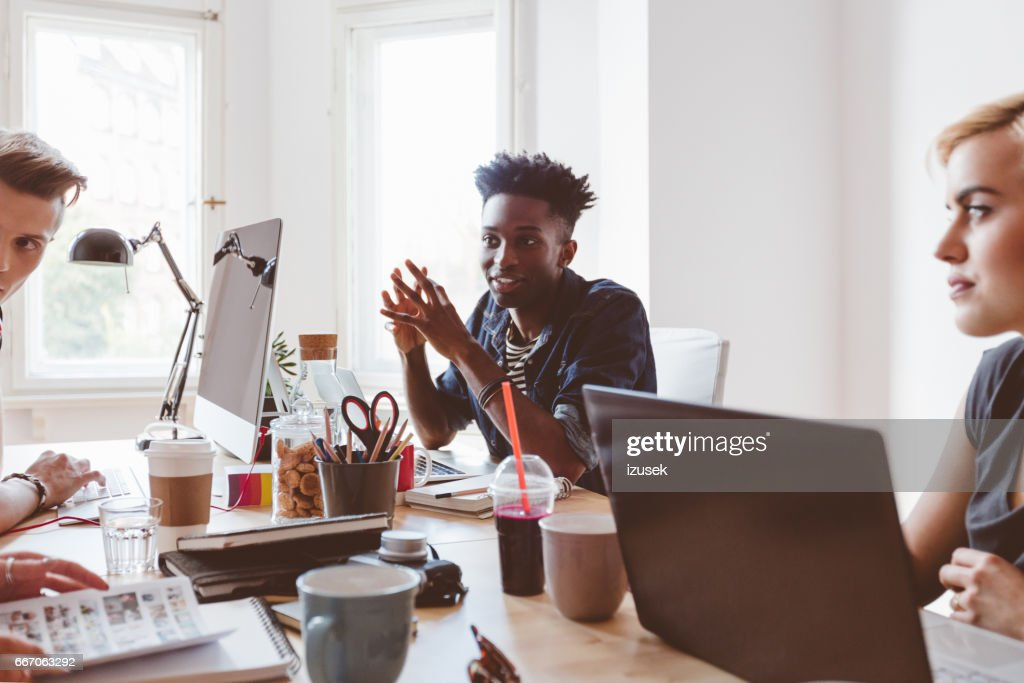 Group of young people discussing working : Stock Photo