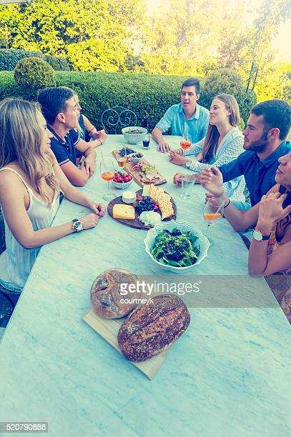 Group of young people eating outdoors