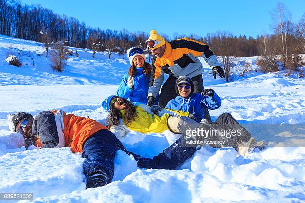 Group of young people enjoying the snow