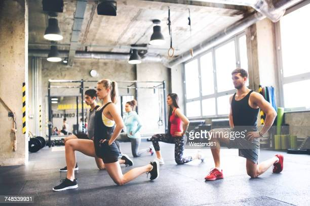 group of young people exercising in gym - small group of people stock pictures, royalty-free photos & images