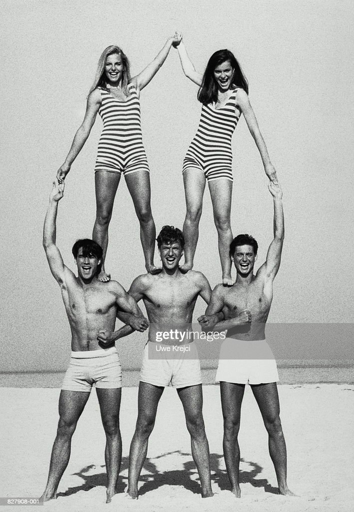 Group Of Naked People Forming A Pyramid Stock Photo