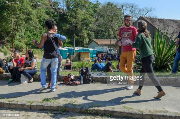 Group of young people fraternizing, dancing and singing at winter festival in the village of paranapiacaba are apulo in brazil