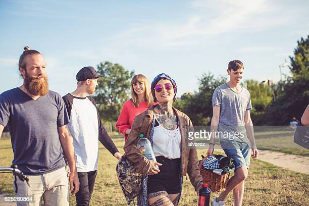 Group of young people going on picnic