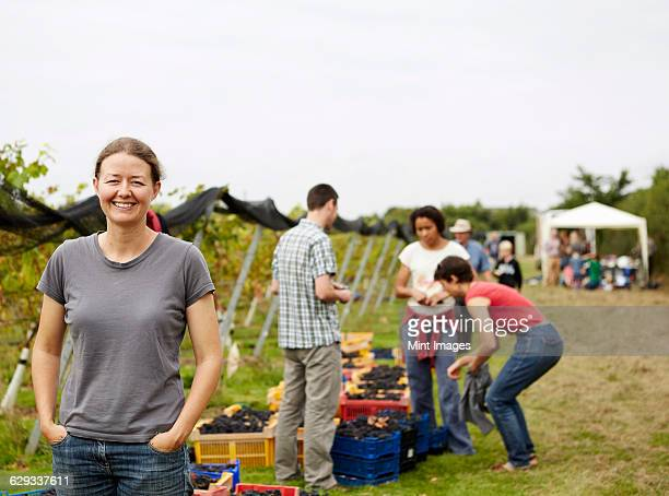 A group of young people, grape pickers, family and the founder of the vineyard celebrating the end of the picking.