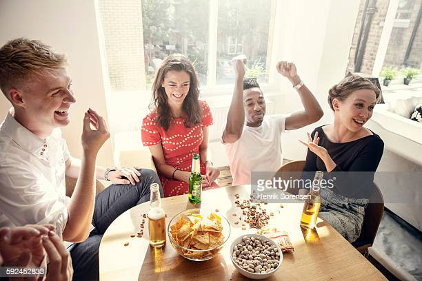 group of young people having a party - nut food stock photos and pictures