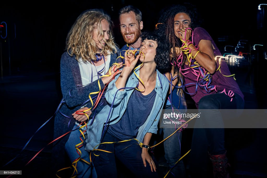 Group of young people having fun at night : Stock Photo