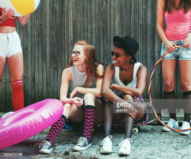 group of young people having fun at party - multi colored hat stock pictures, royalty-free photos & images