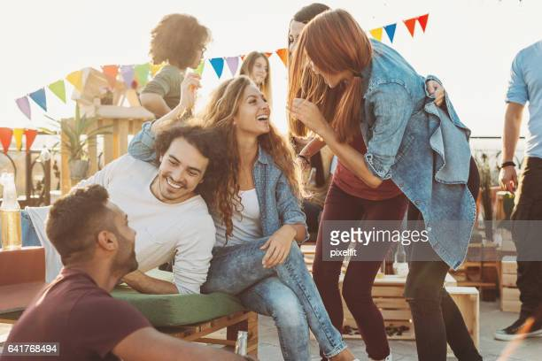 Group of young people having fun on a party