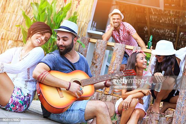 Group of Young people having party on the porch