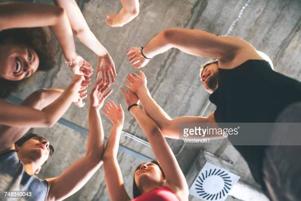 group of young people huddling in gym - achievement stock pictures, royalty-free photos & images