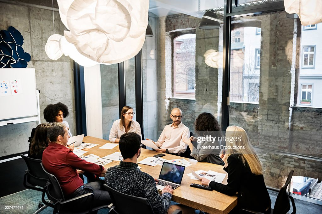 A group of young people in a business meeting. : Stock-Foto