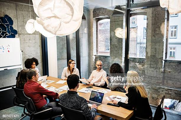 a group of young people in a business meeting. - business finance and industry stock pictures, royalty-free photos & images