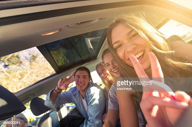 Group of young people in a car.