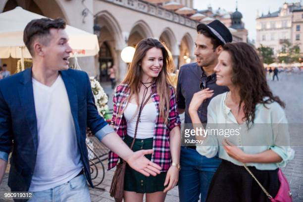 group of young people in a city of cracow (kraków) - krakow stock pictures, royalty-free photos & images
