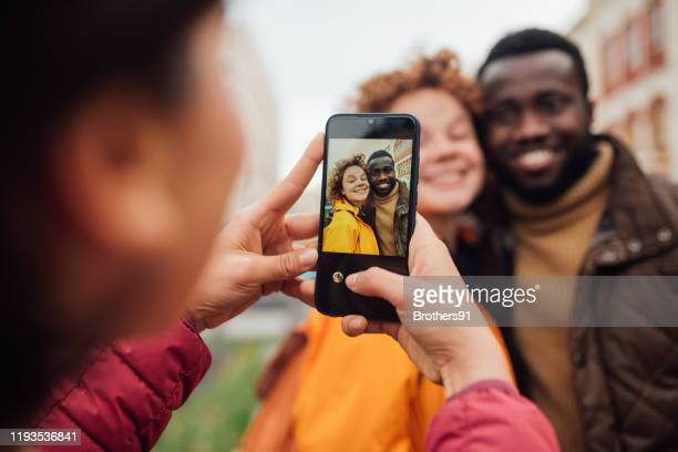 a group of young people in a photo session - photographic equipment stock pictures, royalty-free photos & images
