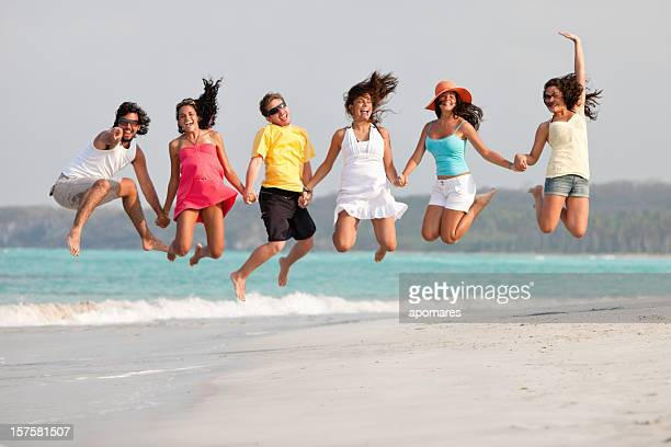 Group of young people jumping in a Tropical beach