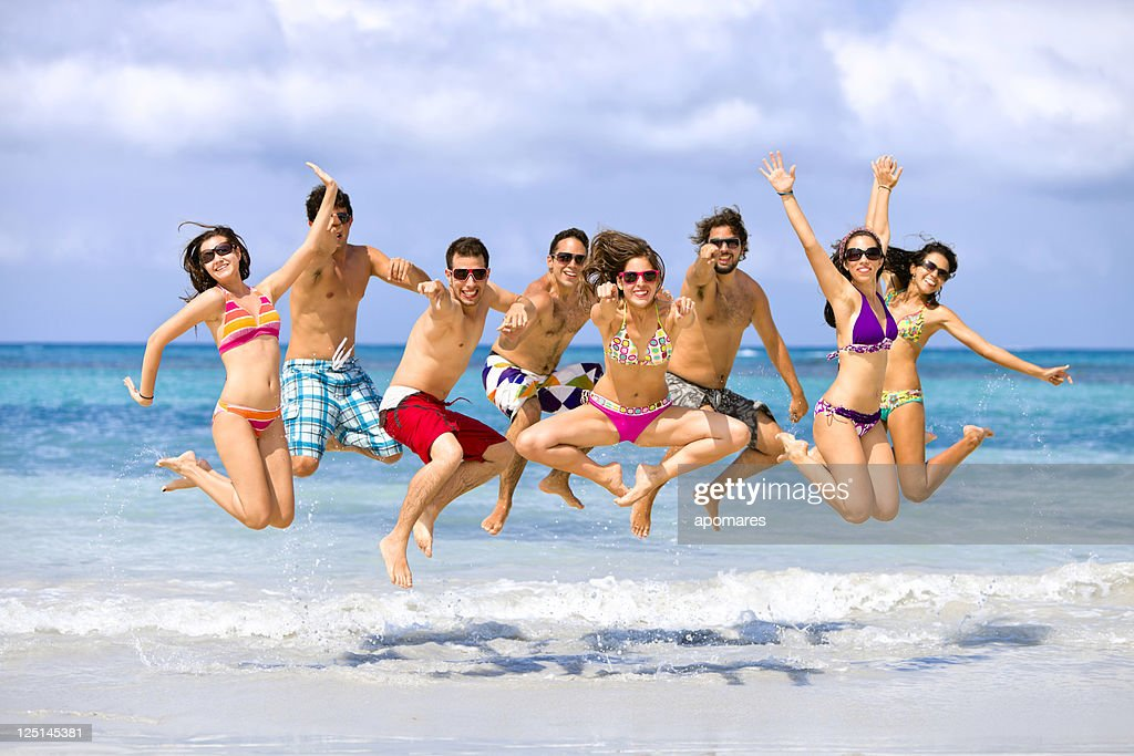 Group of young people jumping on a beach. Spring break. : Stock Photo