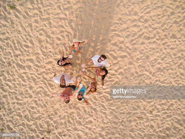 Group of young people making selfie with drone at beach