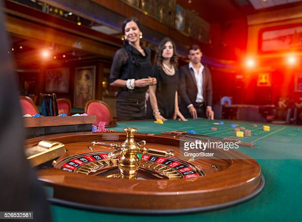 group of young people playing roulette - casino stock pictures, royalty-free photos & images