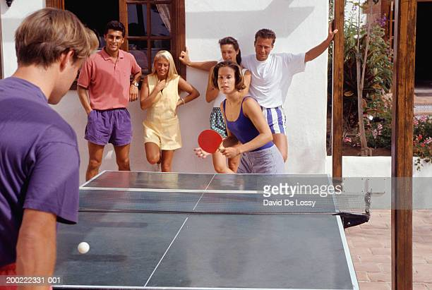 Group of young people playing table tennis