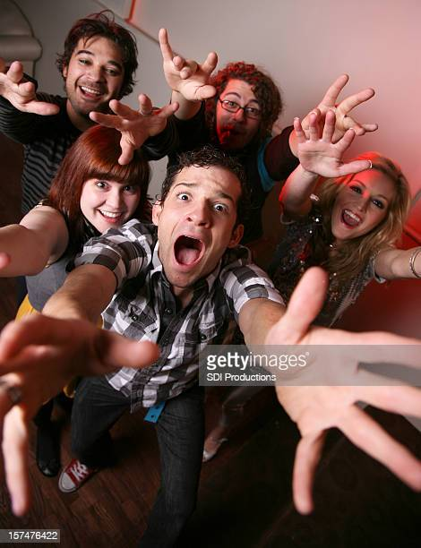 Group of Young People Reaching Out