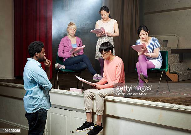 group of young people rehearsing play - rehearsal stock pictures, royalty-free photos & images