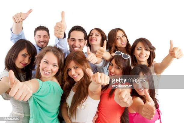 Group of young people showing thumbs up