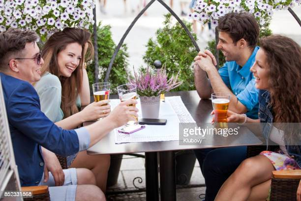 Group of young people sitting in a beer garden