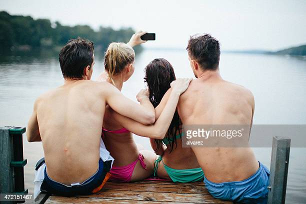 Group of young people taking a photo at the lake