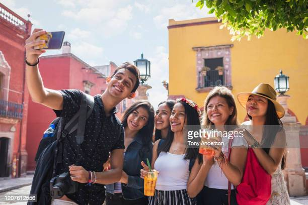 group of young people taking selfie in historic city - women wearing see through clothing stock pictures, royalty-free photos & images