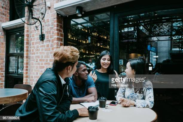 group of young people talking and laughing after discussion - rifka hayati stock pictures, royalty-free photos & images