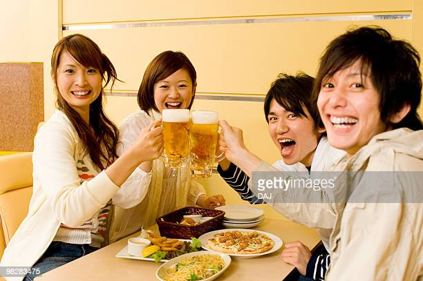 Group of young people toasting beer